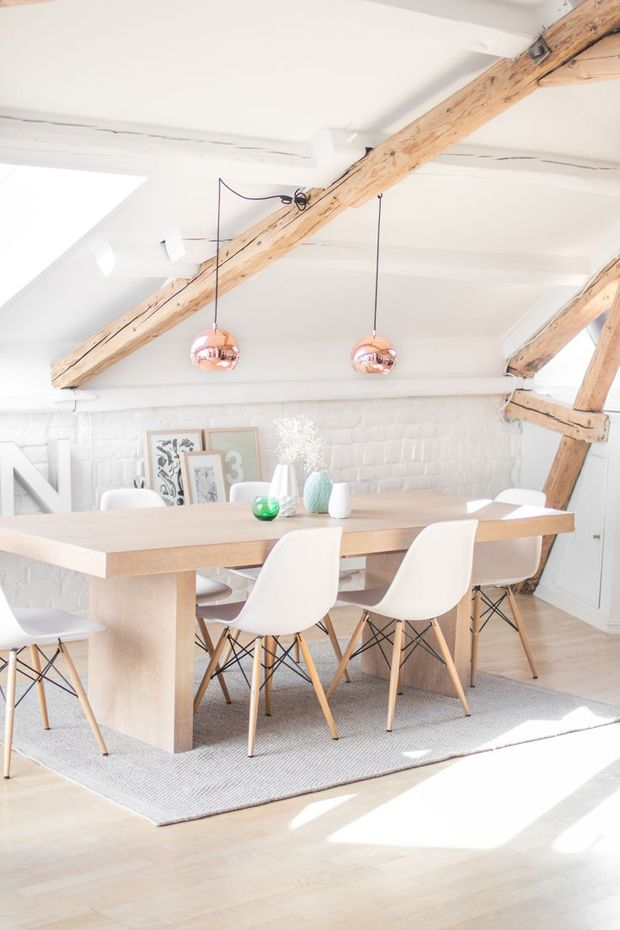 Scandinavian Dining Room with Eames Chairs, bleached wood, copper pendants.
