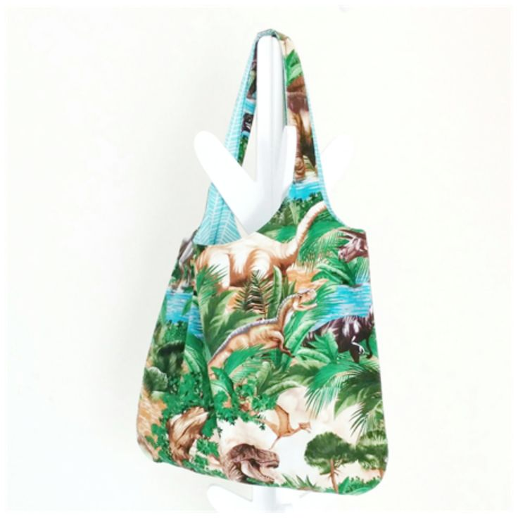 Perfect for trips to the beach, the library, the markets, as a nappy bag or even your everyday handbag! Kids sized tote bag also available. Both styles are fully lined and machine washable. Available in a range of dino-themed 100% cotton prints. Ships worldwide (except North America, due to insurance cover exclusions - sorry) from Australia.