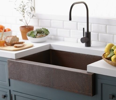 So much to like... The copper sink is stunning. The painted cabinets are lovely and the combination of the two with the juxtaposition of the thick, stark white countertop and subway tile backsplash is terrific. The faucet is well chosen too.