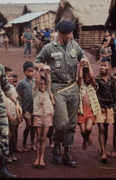 Vietnam - 1964: American advisor, Captain Vernon Gillespie Jr. , playing with local children. (Photo by Larry Burrows/Time Magazine/Time & Life Pictures/Getty Images)