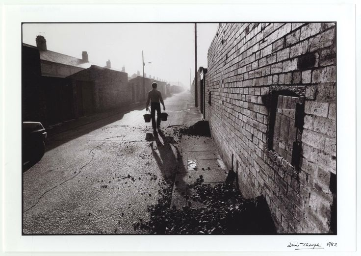 Cleaning up after a coal delivery in Ashington.I remember you had to quickly  clean up any coal the coalman dropped outside the coal hatch before  someone esle 'helped out' and shoveled it up into their bucket.