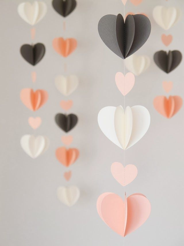 DIY 3D Heart Mobiles could make an adorable backdrop to the head table or ceremony or photo area.