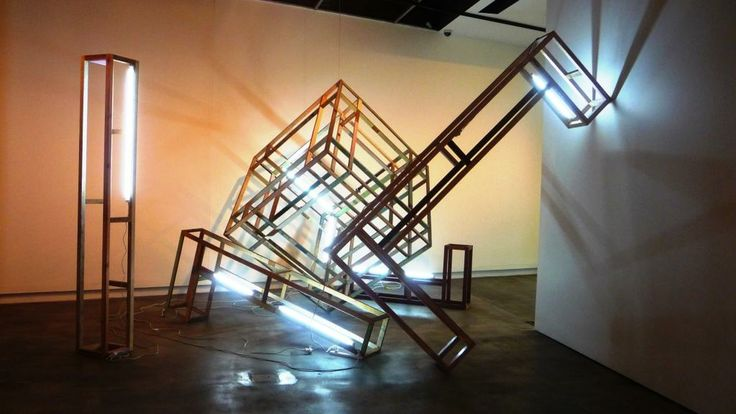 Recycled timber sculpture installation with fluorescent tube lighting.