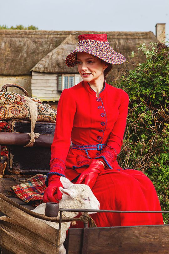 Far From the Madding Crowd (2015) - Carey Mulligan as  Bathsheba Everdene wearing a front-buttoned red dress with ruffled cuffs and blue piping details.  The costumes were designed by Janet Patterson.