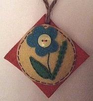 Square ornament w blue flower