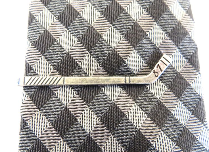 Custom Hockey Stick Tie Bar- Sterling Silver or Antiqued Brass Finish- Personalized Tie Bars by ManKindbyBella on Etsy https://www.etsy.com/listing/178064623/custom-hockey-stick-tie-bar-sterling