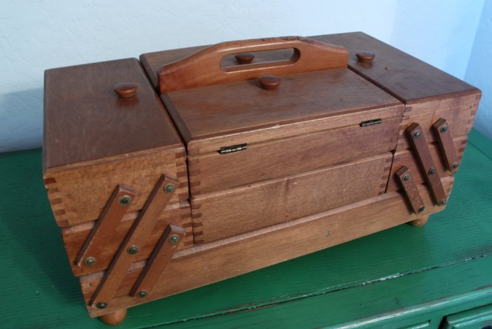 Vintage Accordion Hinged Dovetail Wooden Sewing Box Made in Romania. $79.99, via Etsy.