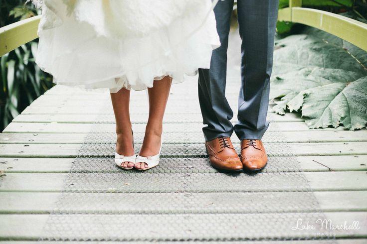 Cute photo on the bridge! Wedding shoes. Photo: Luke Marshall Images