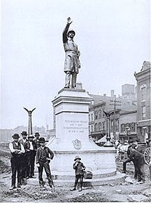 Workers finish installing Gelert's statue of a Chicago policeman in Haymarket Square, 1889. The statue now stands at the Chicago Police Headquarters.