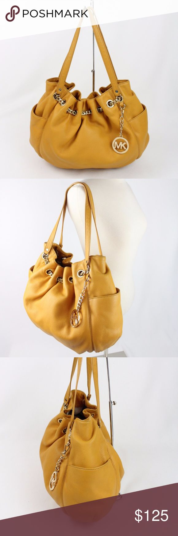 Michael Kors Jet Set Chain Ring Tote Bag Marigold Darling Michael Kors jet set ring tote.  Gently used bag  in great condition.  Very clean interior and exterior! Michael Kors Bags Shoulder Bags