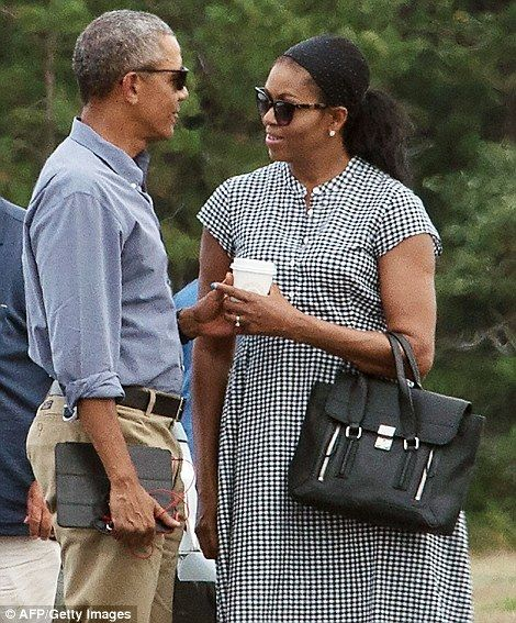 Pictured, Barack and Michelle on the tarmac sharing a coffee...
