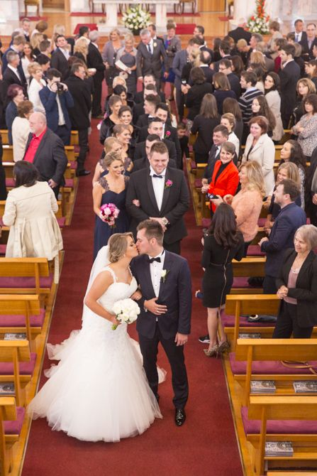 Loving this balcony shot of our bride and groom leading their guests out of the church. Location: St Nikola Tavelic Croatian Catholic Church, St Johns Park #markjayphotography #sydneyweddingphotographer  #weddingphotography