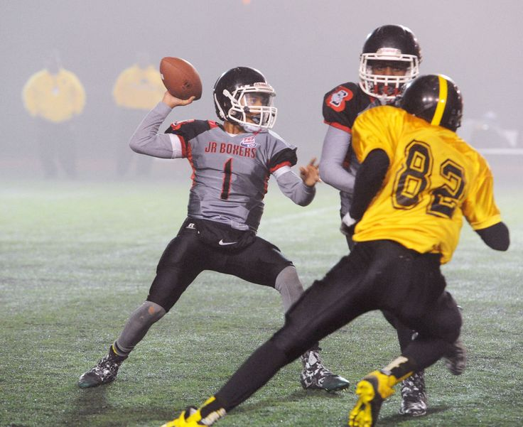 Brockton Junior Boxer quarterback Diamond Blakely makes a pass in the 4th quarter during their New England Pop Warner unlimited division championship game on Friday, Nov. 25, 2016 at Commerce Bank Field Foley Stadium in Worcester. New Haven Steelers defeated the Brockton Junior Boxers 31-8. (Marc Vasconcellos/The Enterprise)