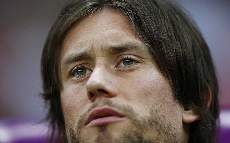 Looking glum: injured Czech midfielder Tomas Rosicky must sit this one out