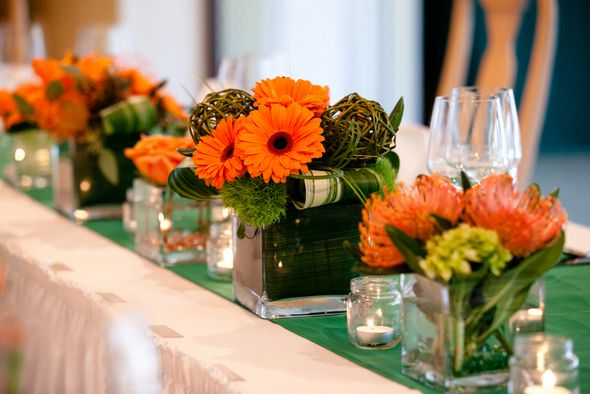 Dark orange, green and beige themed decor for any function