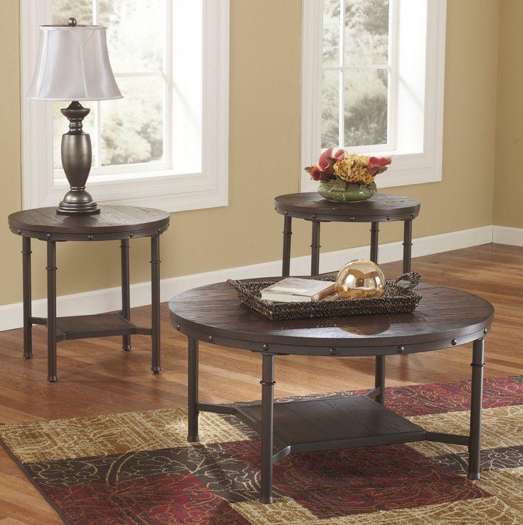 Alluring industrial rustic design. 3 piece dark wood round coffee table set.