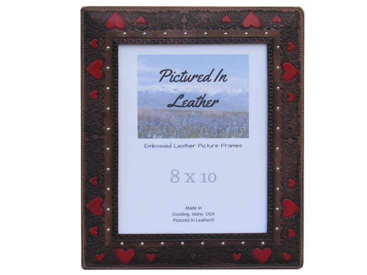 $56   Beautiful 3rd leather anniversary gift! This 8x10 leather picture frame is a perfect blend of beauty, warmth and yet it's classy! With a combination of black with hand painted red hearts this is truly lovely. Perfect wedding frame, anniversary frame or your special family photo frame!