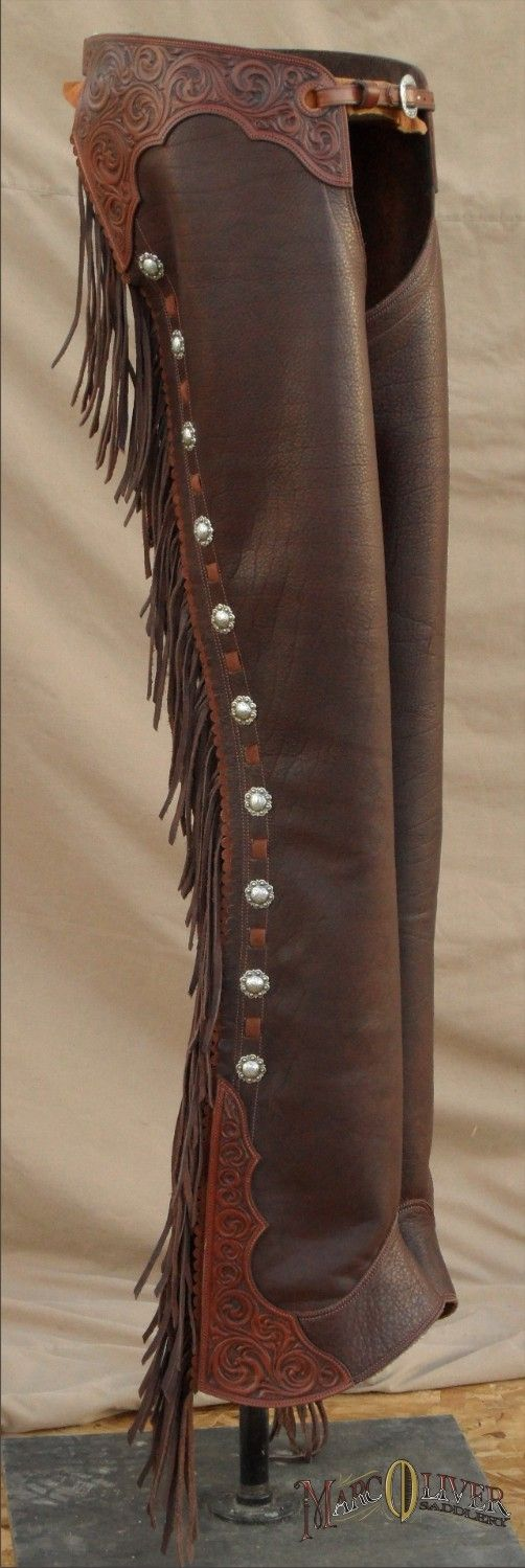 Michaels Chaps - This elegant pair of chaps feature American Bison Leather, Floral tooled Belt and accent, eleastic comfort strip, spur slot and full leg zipper - $875