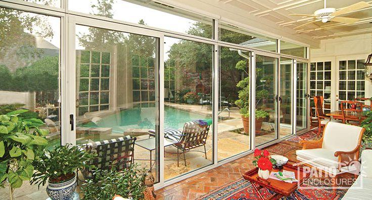 Enclosed porch overlooking pool (Interior). See more porch enclosures here: http://www.patioenclosures.com/porch-enclosure-pictures.aspx
