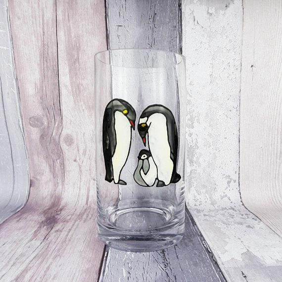 This glass vase features a family of Emperor penguins (Mum, Dad and baby) hand painted in a stained glass style. The penguin parents are bending over to look at their baby penguin standing between them.  This would make a great gift for parents at Christmas or Mum on Mothers Day and Dad