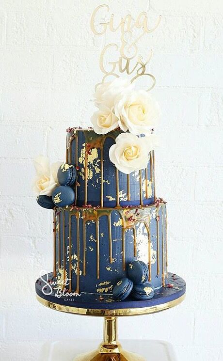 Navy, gold and salted caramel drip cake
