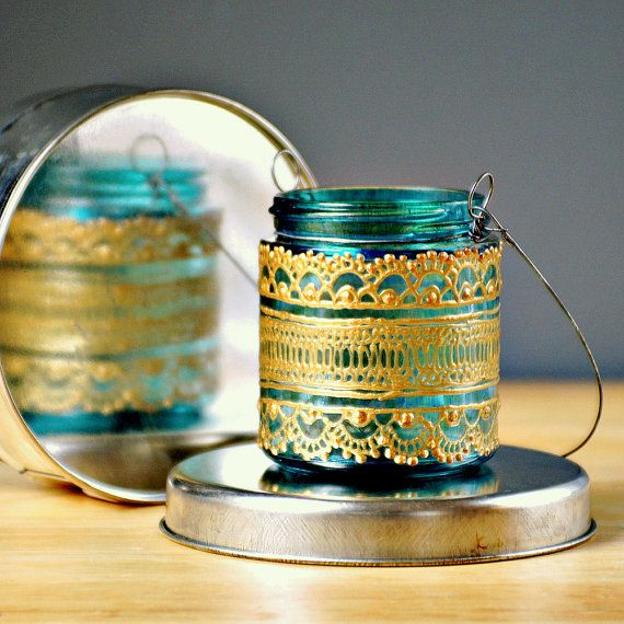 Hand Painted,Moroccan Jar Candle/ Hanging Mini Lantern, Aquamarine Glass With Gold Accents. $12.00, via Etsy.