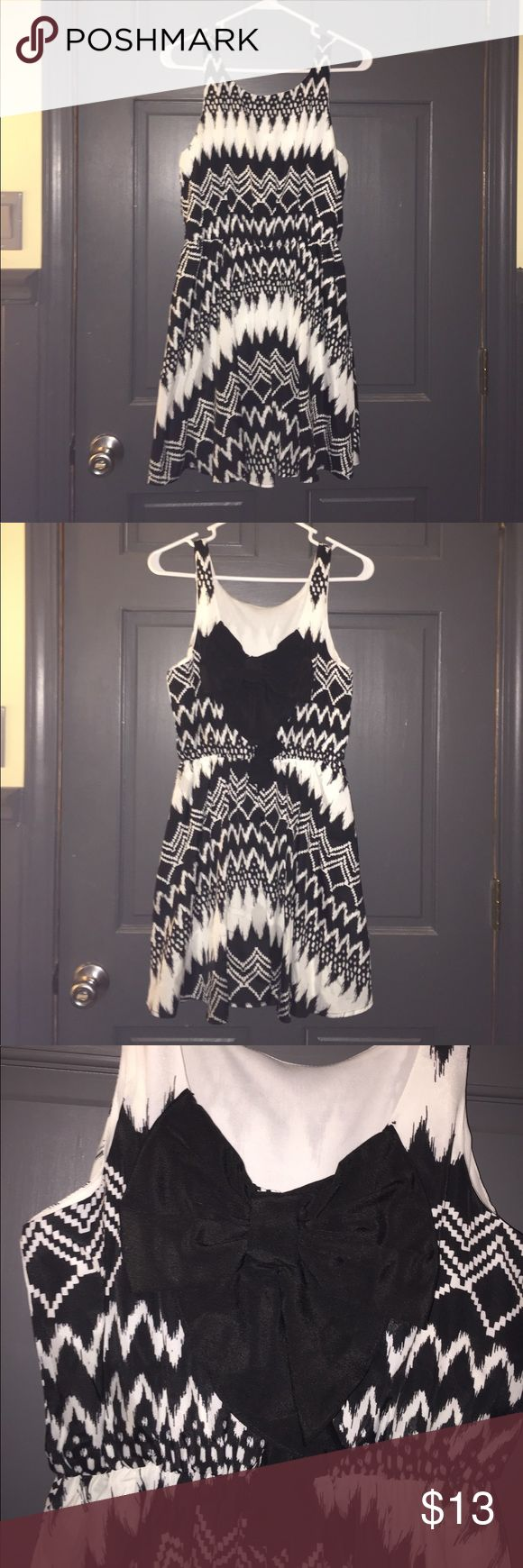 Super cute black and white aztec print dress! This black and white aztec print dress is super cute. Can be dressed up or down and is perfect for any occasion. It may seem simple on the front, but the back has a super cute black bow to make it not like any other black and white dress. Worn a few times and is in perfect condition! Rewind Dresses