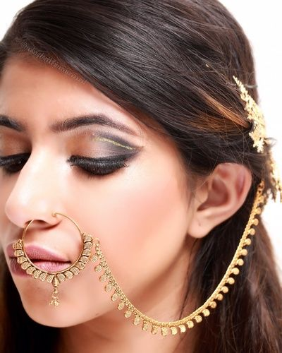 Indian Bridal Makeup - Copper and Black Smokey Eye | WedMeGood | Copper and Black Smokey Eye with a Gold and Stone Nath, Nude Pink Lips and Nude Makeup #wedmegood #indianbride #indianwedding #nath #smokeyeye #black #copper
