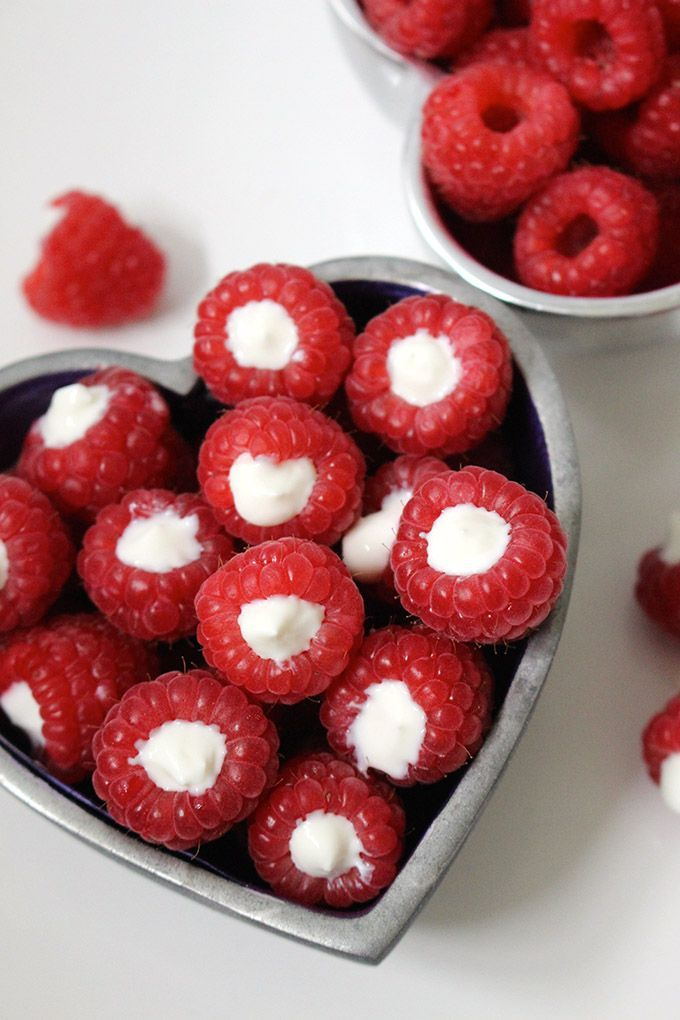 These yogurt filled raspberries are a delicious and healthy snack. Your kids will love to help prepare these (and of course eat them)