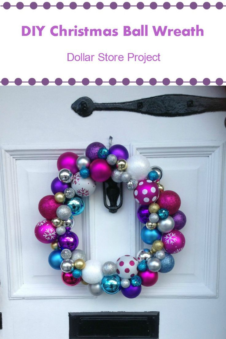 DIY Christmas Wreath - rainbow ornaments! This wreath will be a unique addition to your door to make your neighbours jealous. This is a dollar store craft, but definitely looks more expensive! #DIYwreath #Christmaswreath