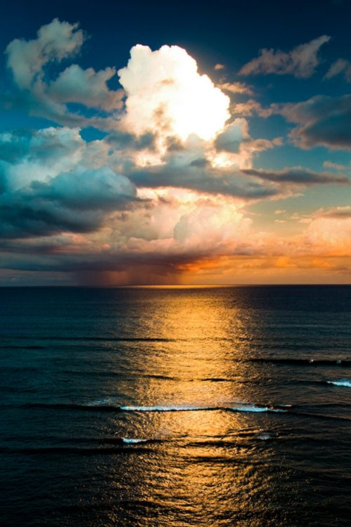 High pressure clouds lit from the sun, and glowing down on the sea ~ by Cameron Brooks