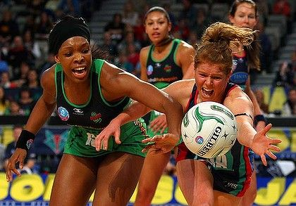 Close call: Eboni Beckford-Chambers of the Fever and Vixens' Tegan Caldwell vie for possession yesterday.