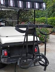 A most important Yamaha golf cart accessory is an attached golf bag rack - this one slides on and off the safety bar.