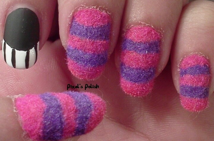 Cheshire Cat nails by Pixel's Polish. Clever idea.