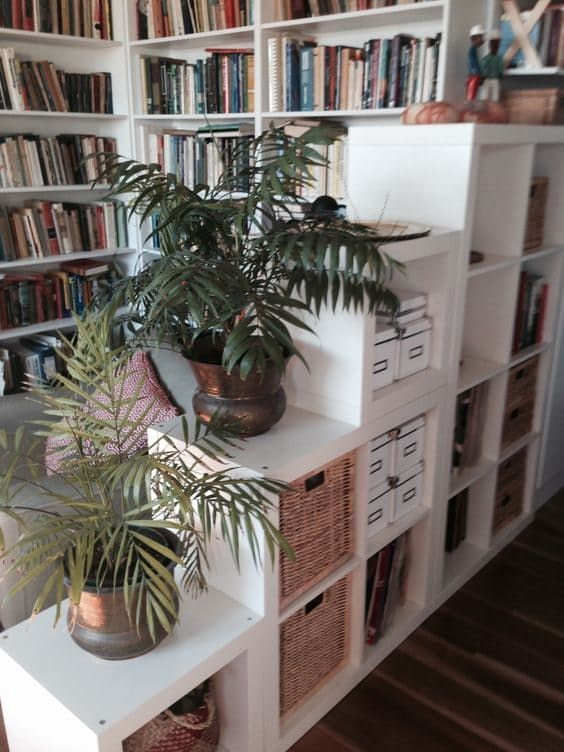15 Super Smart Ways to Use the IKEA Kallax Bookcase. These stacked and staggered Expedits make for a room divider that's both interesting and useful.