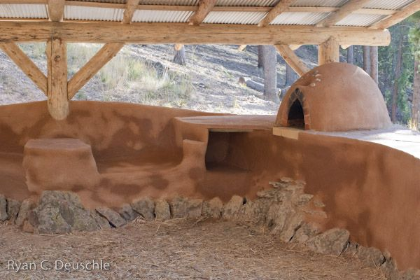 Cob courtyard with cob oven - love the idea of a separate outdoor kitchen. Each year a homeowner could add to the seating area until satisfied or do it all at once.