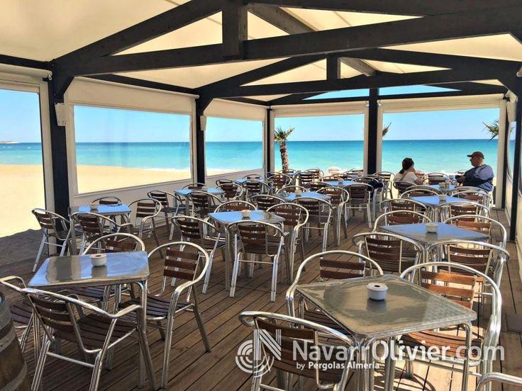 Pérgola de playa con lona PVC, cerrada con toldos abatibles.Tarima de madera autoclave riesgo IV especial  para exteriores. www.pergolasalmeria.com