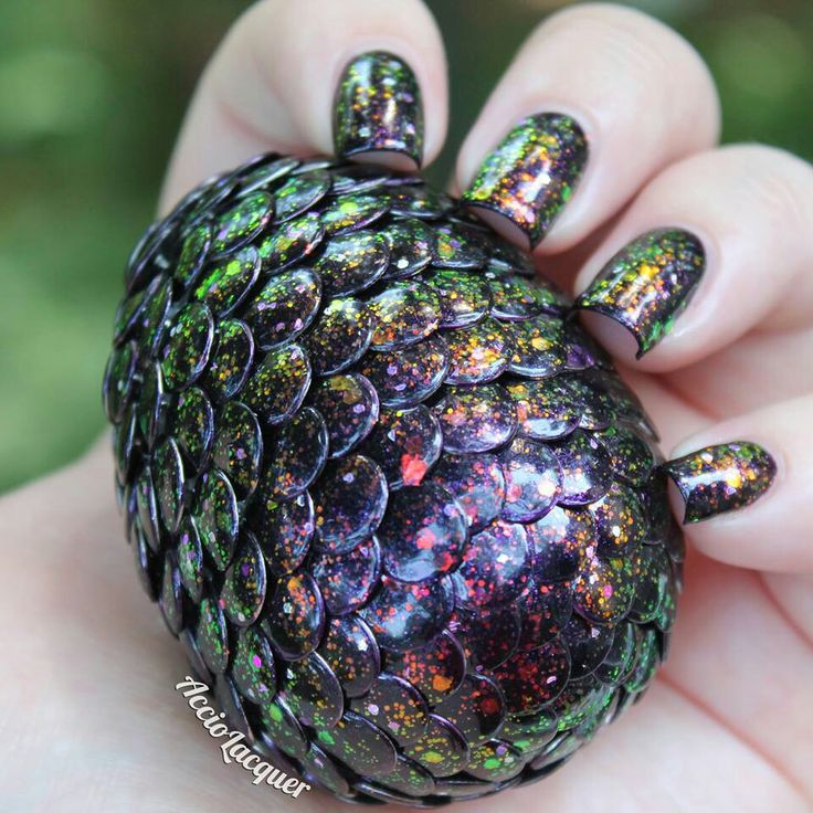 """""""Dragon egg"""" - styrofoam egg covered in painted thumbtacks (black with a shimmery flecked nail polish over top )"""