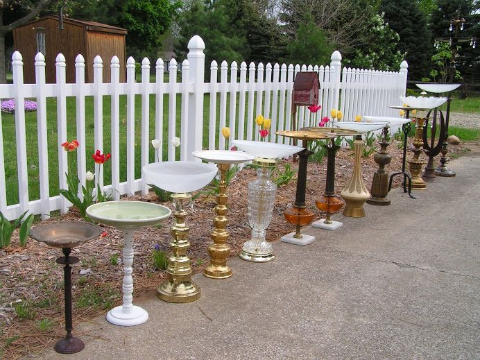 Lamp bases and ceiling fixtures turned into bird baths and bird feeders! And now to find some of these things