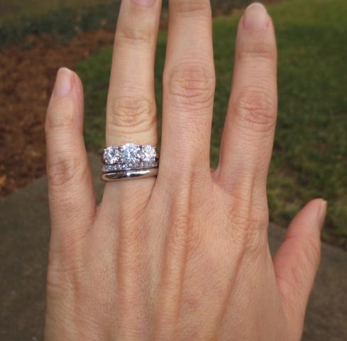 Three-stone diamond ring with wedding bands