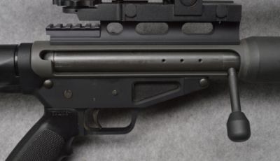 Safety Harbor Ultra 50    Bolt-action magazine fed upper for the AR-15 lower, although the one pictured does not have the standard magwell. This particular example is a bit unique in that its chambered in .510 DTC. The cartridge is similar to the 50 BMG but was developed to be used in countries where gun owners are not allowed to have calibers that are actively fielded by military forces.