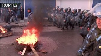 0:59  Tear gas & stones: Argentinian police evicts fired factory workers