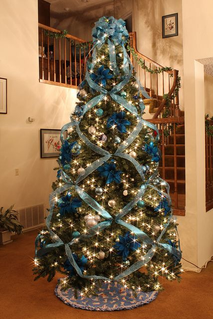 blue and silver elegant christmas tree with cris cross ribbon - Decorative Christmas Trees