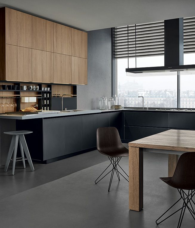 Poliform kitchen - anodized aluminium base units , pearl grey Corian worktop , elm wall units . Solid oak table.