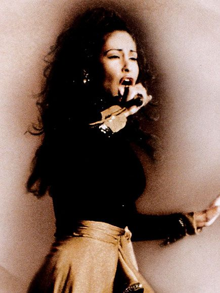 Selena Quintanilla and her famous curly locks.