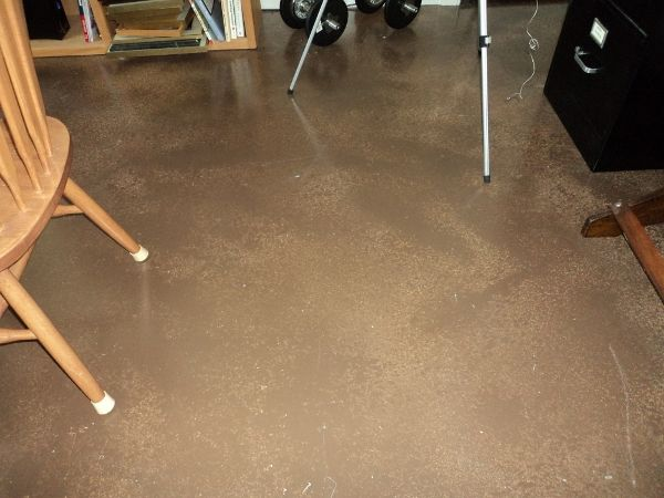 Painted concrete floor is sturdy and practical in an area of heavy use. http://www.designingyourperfecthouse.com