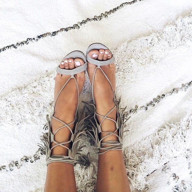 Fringe lace up heels.