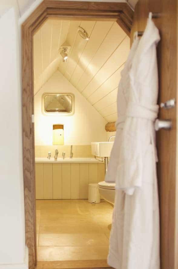 pretty country attic bathroom - tongue and groove panelling  Temple Guiting Barn - thebeautifulhousecompany