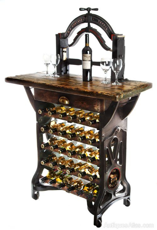 """The Henley"" wine tasting table and storage rack, is a completely unique item, which we have converted from a cast iron Victorian mangle. This lovely piece of history, has now been adapted to a functional piece, which will grace any bar, restaurant or home."