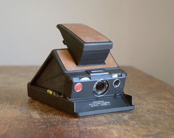 A seemingly older, but equally precious, Polaroid Camera. Now that I want.